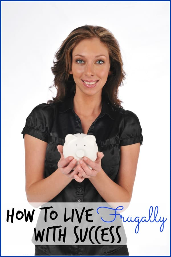 Businesswoman holding a piggy bank on a white background