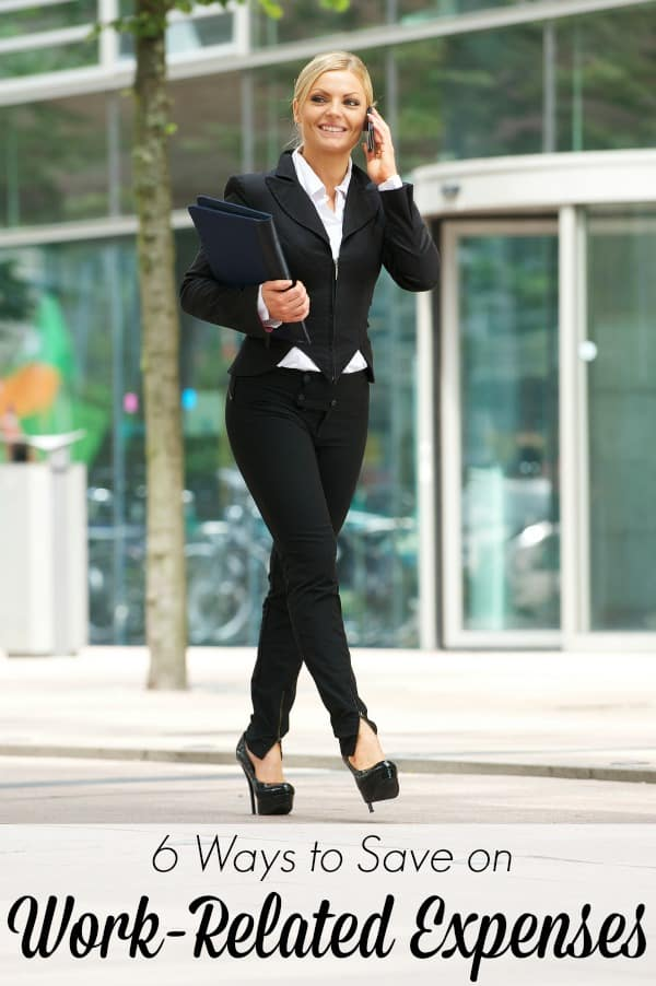Portrait of a happy business woman walking outdoors and talking on mobile phone