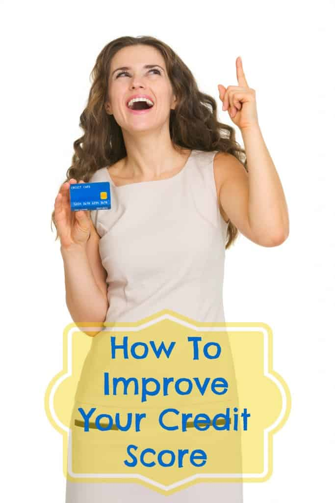 Happy young woman with credit card pointing on copy space