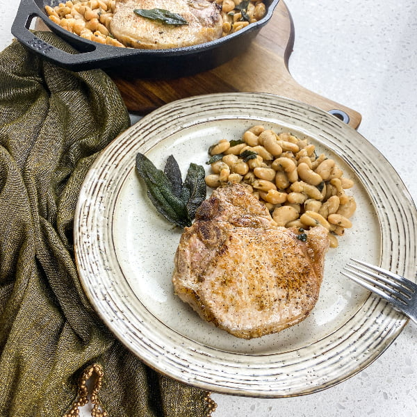 The Most Amazing Tuscan Pork Chops with White Beans and Crispy Sage